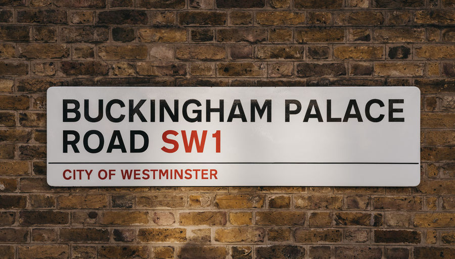 Street name sign on buckingham palace road, a famous street in london, uk.