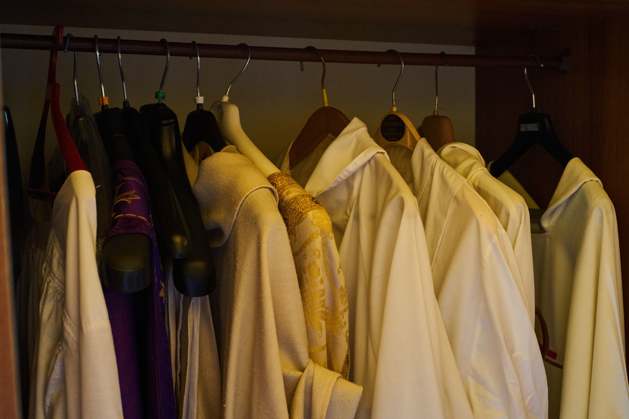 Close-Up Of Clothing On Hangers For Sale