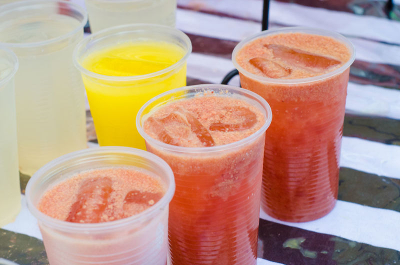 High Angle View Of Fresh Juices At Market Stall