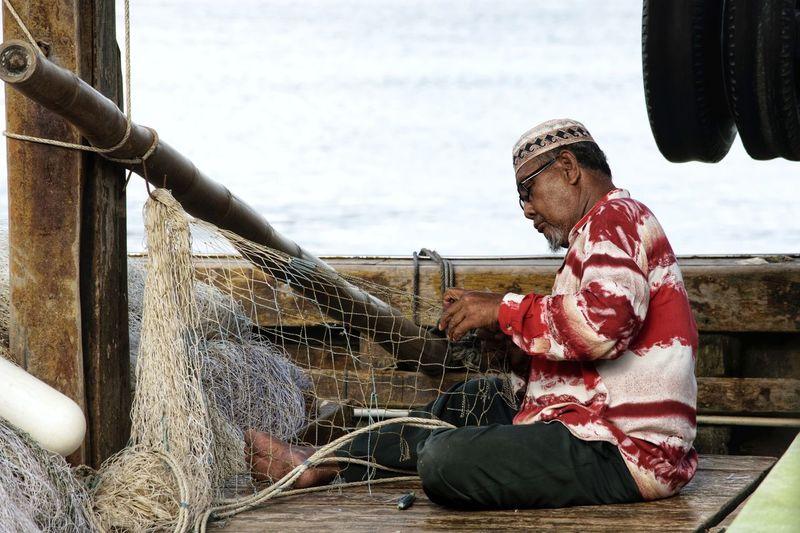 Man Weaving Fishing Net