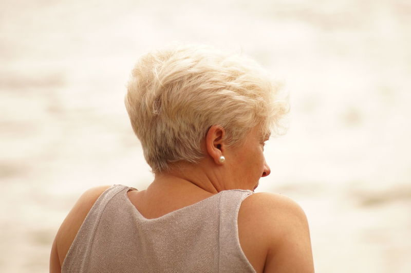 Close-Up Of Woman With Short Hair Outdoors