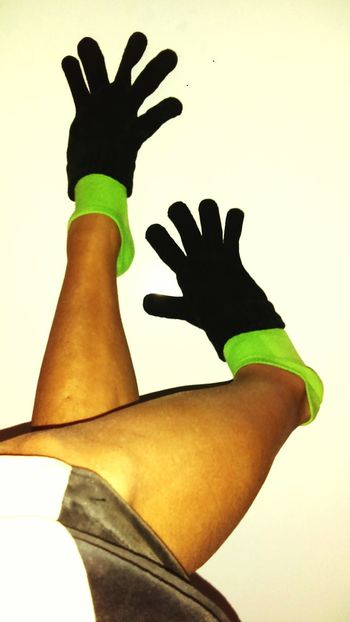 TK Maxx Socksie Human Leg Low Section Warm FeetGreen Color Indoors  Helping Others Sock Limb Stocking Up Cold Feet Black Gloves White Background Green And Black Human Body Part Premium Collection