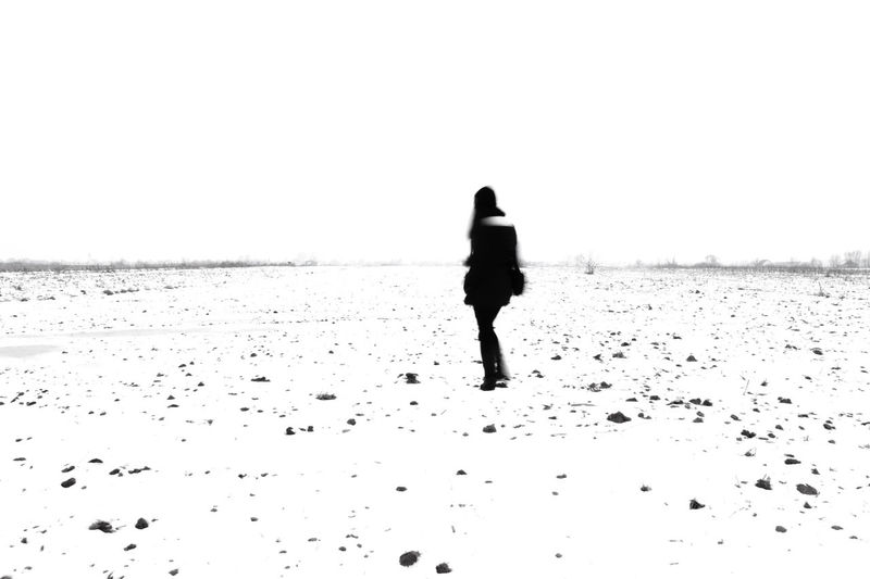 Adult Alone Beach Beauty In Nature Clear Sky Cold Temperature Day Full Length Girl Girls Horizon Over Water Leisure Activity Melancholy Nature One Person Outdoors People Real People Rear View Sad Sand Sea Sky Walking Winter