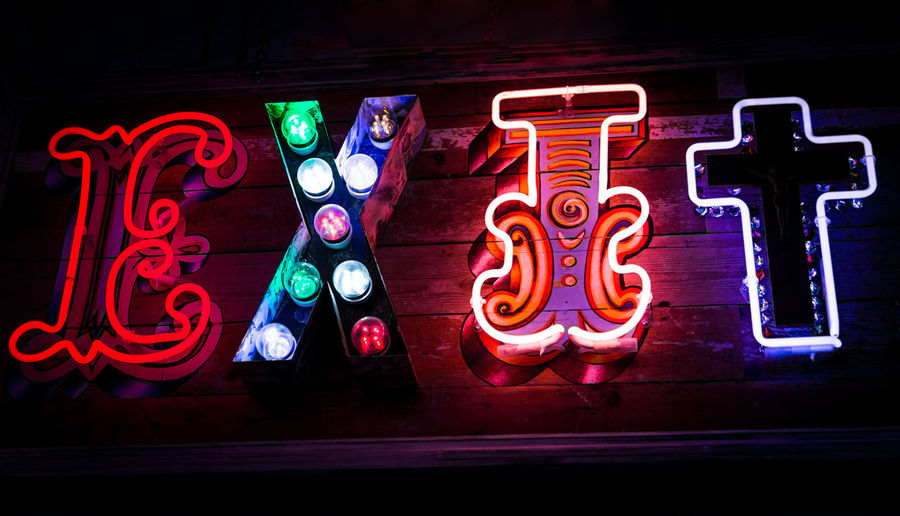 Backgrounds Creativity Exit Horizontal Ideas Illuminated Indoors  Leaving Neon Neon Light Night Nightlife No People Outdoors Text Vibrant Colour