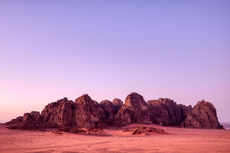 Rock formations on landscape against clear sky - wadi rum, jordan
