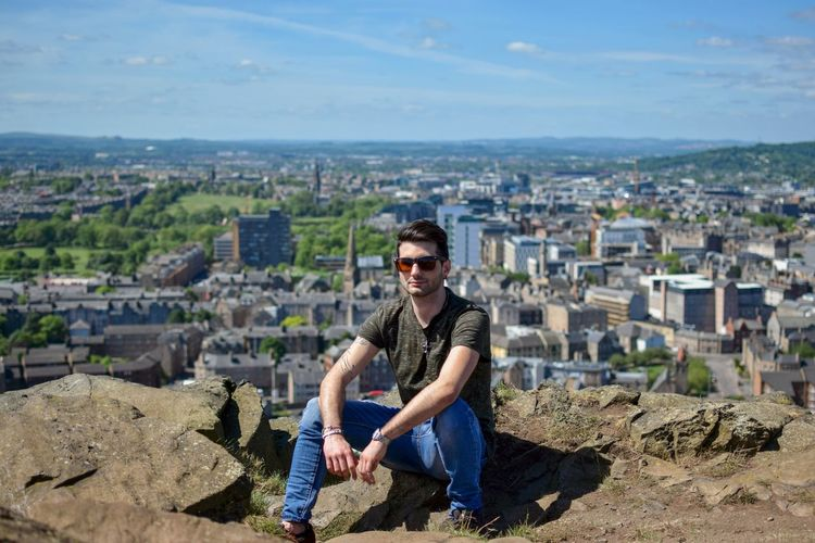 Only Men One Man Only Outdoors Adult Built Structure Day Sky Sitting Landscape Men Sunlight Nature Dreams Dreaming Building Exterior Cityscape Portrait Edimburgh Holyrood Park Edimburgo Your Ticket To Europe