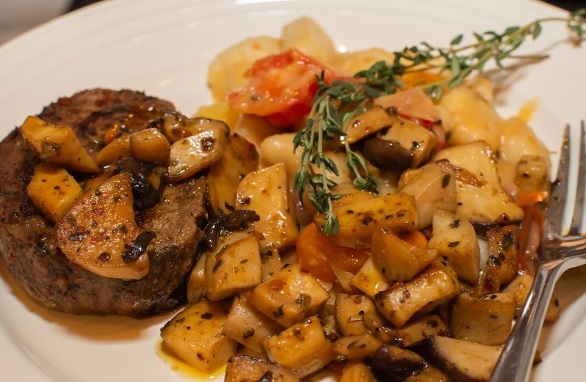 Steak with mushrooms and gnocchi Ready-to-eat Mushroom Food And Drink Meal Steaks Food Food And Drink Ready-to-eat Freshness Healthy Eating Still Life Vegetable Indoors  Close-up Wellbeing Plate Serving Size No People Potato Tomato High Angle View Table Meal Prepared Potato