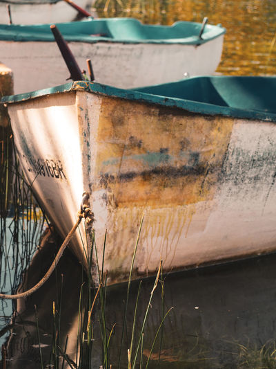 Close-up of rusty ship in water