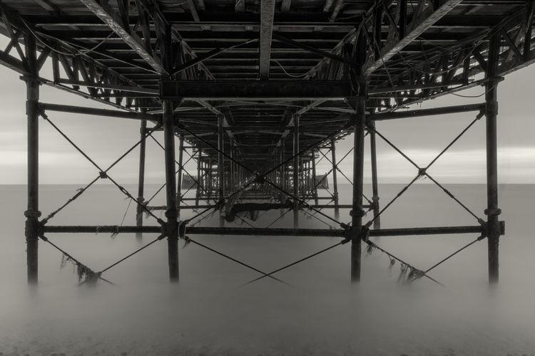 Underneath view of pier in sea