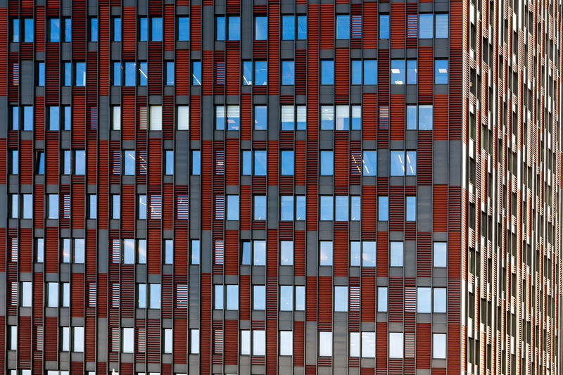 Front view on a facade of modern office building as texture, background, abstract - Image No People Backgraund Wallpaper Pattern Texture Architecture Close-up Details Building Exterior Built Structure Building Full Frame Window Office Office Building Exterior City Backgrounds Day Red Modern Glass - Material Reflection Low Angle View Outdoors Skyscraper Apartment Glass Façade Exterior Modern Office Home Abstarct High Construction Structure Business Residental Downtown Estate Front View Design Outdoor Block Steel Flat Cityscape Mirror Reflection Corporate City