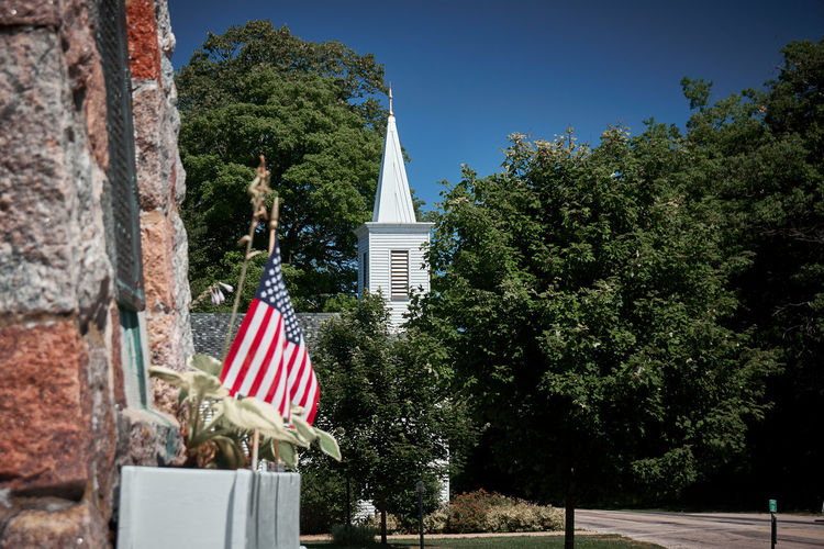 American American Flag Americana Blue Church Clear Sky Day Flag Historic History Identity Low Angle View National Flag Outdoors Patriotism Religion Tree Wind