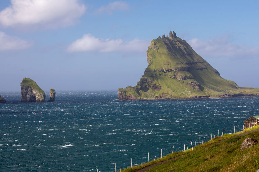 Coastline Stormy Weather Tadaa Community Beach Beauty In Nature Cloud - Sky Day Faroe Islands Green Color Idyllic Land Mountain Nature No People Non-urban Scene Outdoors Rock Scenics - Nature Sea Sky Stack Rock Tindhólmur Tranquil Scene Tranquility Water