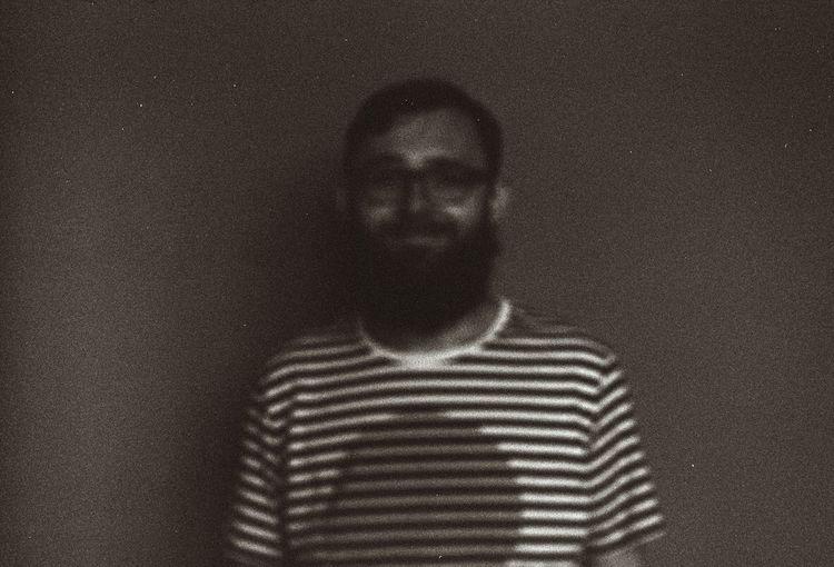 Portrait of man standing on floor