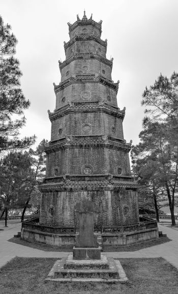 Thien Mu pagoda. Viet Nam Country Hue Vietnam Hue City Pagoda Thien Mu Pagoda Architecture Black Blackandwhite Building Building Exterior Built Structure Day History Low Angle View Nature No People Outdoors Place Of Worship Plant Religion Sky Tourism Travel Destinations Travels Tree