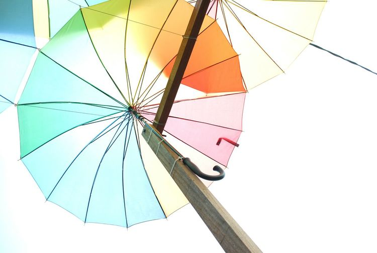 Low Angle View Of Umbrella Against Clear Sky