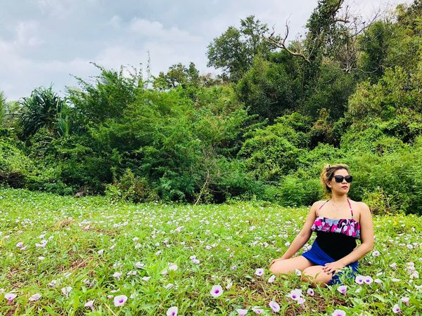flowers every where Flowers Sandals Only Women Adults Only Adult One Person One Woman Only People Sitting Green Color Tree Grass Beautiful Woman