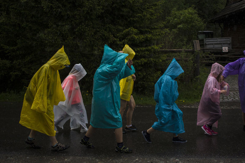 People wearing raincoats