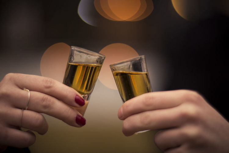 Alcohol Alcoholic  Alcoholic Drink Beverages Bokeh Bokeh Lights Celebratory Toast Cheers Cheers! Close-up Drink Drinking Glass Food And Drink Glasses Hands Happy Hour Holding Human Hand Indoors  Shot Glass Shot Glasses Shots Whiskey Whisky