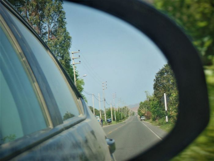 Car Car Interior Close-up Day Driving Espejo Land Vehicle Landscape Mode Of Transport No People Outdoors Paisaje Rear-view Mirror Retrovisor Road Side-view Mirror Sky Street Transportation Traveling Tree Vehicle Interior Vehicle Mirror Windshield