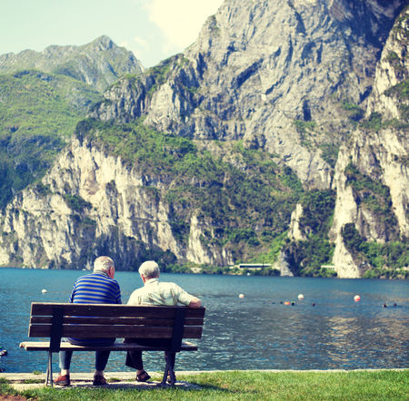 Old age people resting on bench at lake Garda Lake Garda Old Age Old Age People Retired Retirement Retirement Plan Tranquil Scene Unrecognizable Person