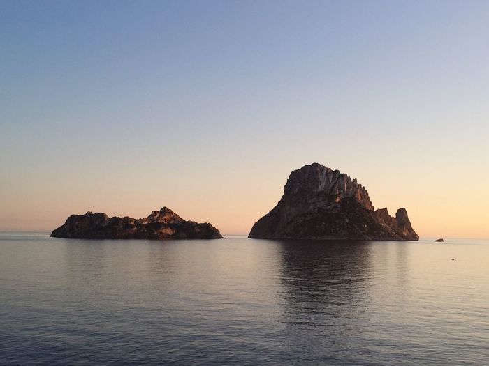 Ibiza Es Vedra, Sunrise, Yellow, Orange, Scenic, Clouds, Beach, Sea Es Vedrá Sky Water Sea Beauty In Nature Tranquility Scenics - Nature Sunset Tranquil Scene No People Clear Sky Rock Non-urban Scene Rock - Object Nature