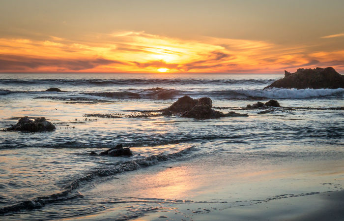 Sunset on the beach in Cayucos, California Beach Cayucos Coastline Horizon Over Water Majestic Ocean Outdoors Rippled Scenics Sea Seascape Shore Sunset Surf Tranquil Scene Vacations Water Waterfront Wave