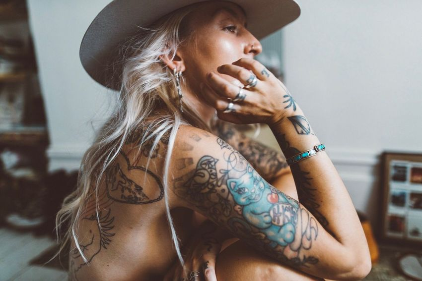 Tattoo One Person Indoors  Lifestyles Real People Leisure Activity Beautiful Woman Portrait Young Women Young Adult Day Close-up People Eliza Happiness Women Indoors  Hat