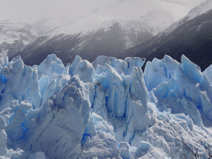 Close up of glacier Perito Moreno, El Calafate, Santa Cruz, Patagonia/ Nahaufnahme des Gletschers Perito Moreno, Patagonien Eis El Calafate Frost Gletscher Gletscherblau Perito Moreno Glacier Perito Moreno. Patagonia. Argentina. Argentina Beauty In Nature Blue Cold Temperature Day Environment Frozen Glacier Glacier Blue Ice Iceberg Kingfisher Blue Landscape Mountain Mountain Peak Nature No People Non-urban Scene Patagonia Patagonien Perito Moreno Scenics - Nature Snow Snowcapped Mountain Tranquil Scene Tranquility Water White Color Winter