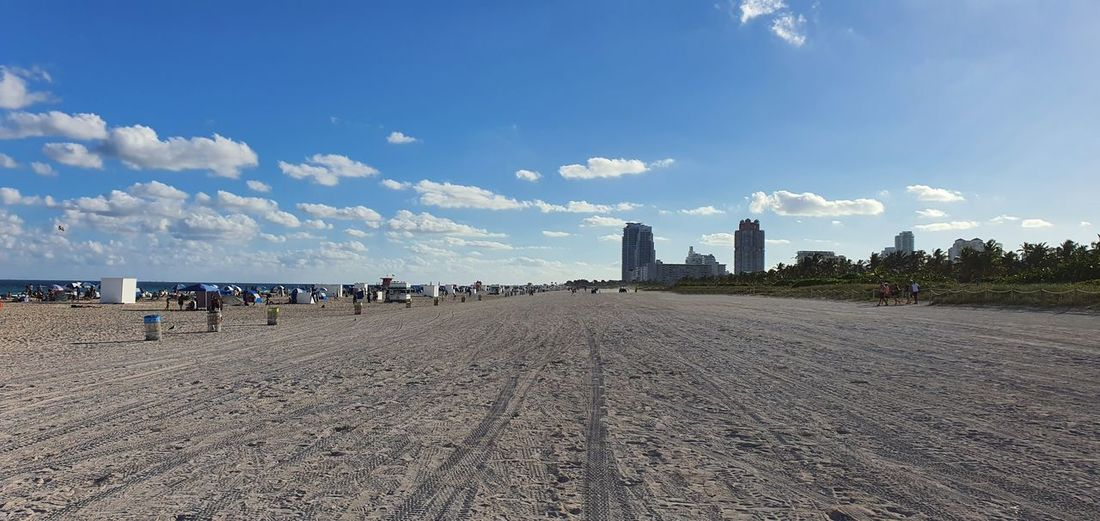 Panoramic view of beach and buildings against sky