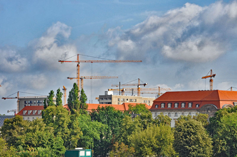 Buildings And Cranes In City