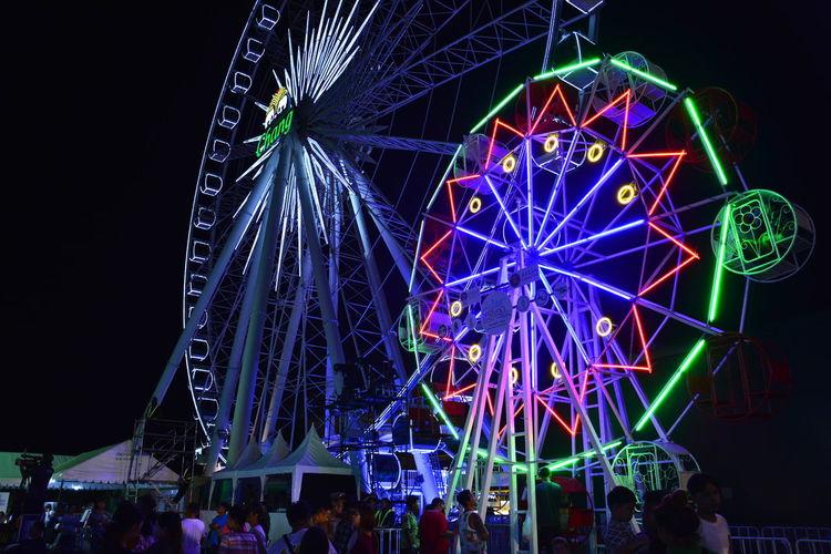 Low angle view of illuminated ferris wheel at night