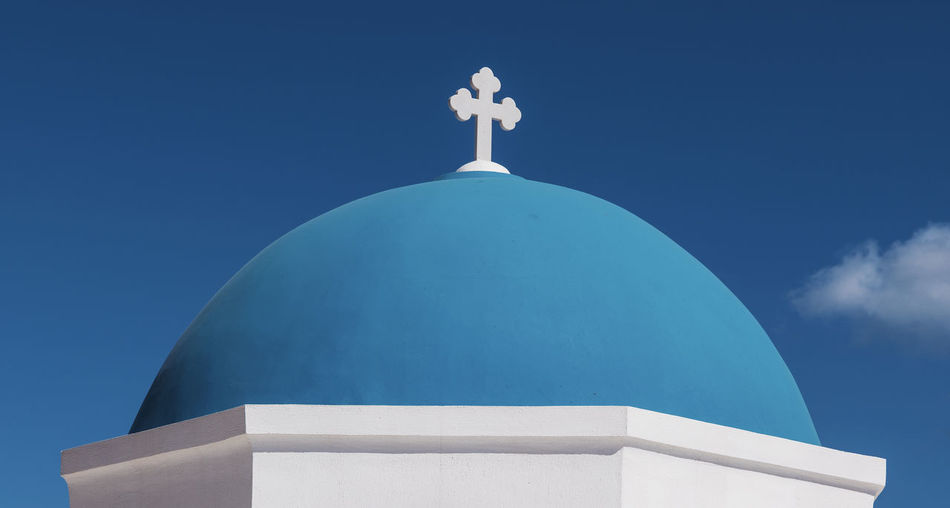 Iconic Blue Church Dome of Santorini Christian Greek Architecture Belief Blue Building Building Exterior Built Structure Cross Day Dome Greece Nature No People Orthodox Outdoors Place Of Worship Religion Santorini Sky Spirituality