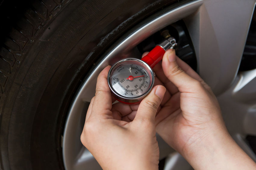 Tire pressure gauge : Hand holding pressure gauge checking air pressure for car tire. Safe driving. Car Check Caucasian Ethnicity, Checking In Driving Machinery Measuring Mechanic Pressure Gauges Transportation Wheel Working Auto Mechanic Auto Repair Shop Car Caucasian Ethnicity Equipment Examining Gauge Human Hand Instrument Of Measurement Physical Pressure Pressure Gauge Safe Driving Tire Tire Pressure Transportation Building - Type Of Building Hand Machinery Accuracy Human Body Part