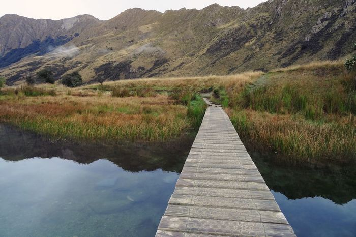 Nature The Way Forward Mountain Landscape Beauty In Nature Tranquility Scenics No People Tranquil Scene Outdoors Day Grass Sky Wooden Water Reflections Mirror Lake Lake Moke Lake New Zealand Hiking Travel Morning Morning Light Mountain Range Calm