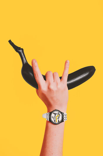 POP the clock Banana EyeEm Best Shots Market Pop Art Rock Body Part Colored Background Copy Space Cut Out Finger Hand Holding Human Body Part Human Finger Human Hand Indoors  Lifestyles One Person Real People Studio Shot Time Watch Wristwatch Yellow Yellow Background A New Beginning