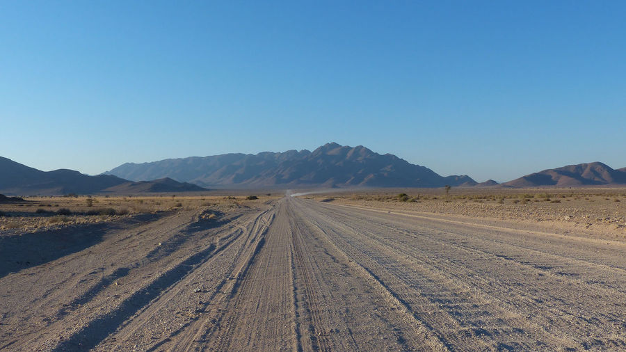 Landcape in Southern Namibia, Africa Arid Arid Landscape Clear Sky Mountain Mountain Range Nature Non-urban Scene Outdoors Remote Road Roadtrip Scenics The Way Forward Tranquil Scene Tranquility