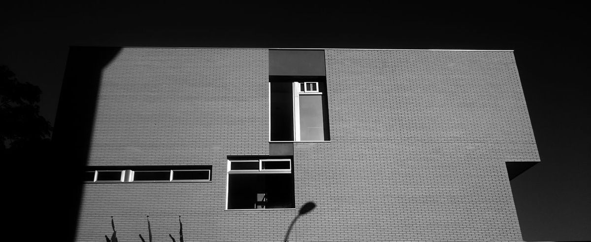 Brick Wall Architecture Black And White Blackandwhite Building Building Exterior Built Structure Close-up Closed Day Light And Shadow Monochrome No People Outdoors Pattern Shadow Sign Sunlight Wall - Building Feature Window