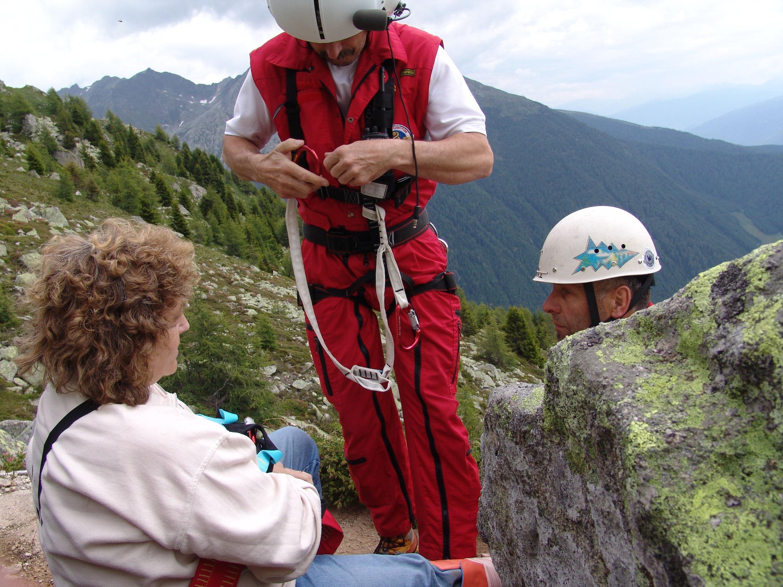 TOURIST STANDING ON MOUNTAIN LANDSCAPE