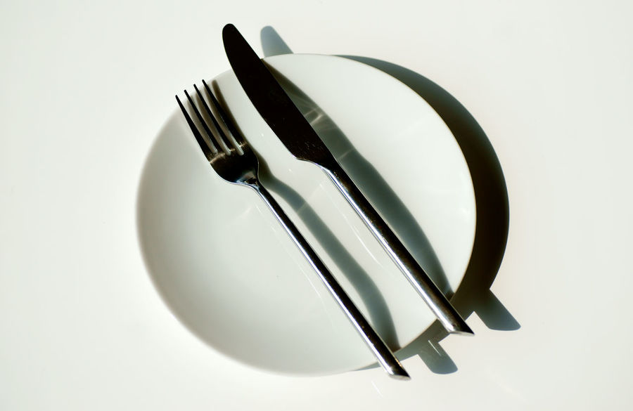 Kitchen Utensil Fork Indoors  White Background Studio Shot Still Life Eating Utensil Close-up No People Shadow Household Equipment White Color Copy Space Food And Drink Table Plate High Angle View Metal Two Objects Knife Table Knife Silver Colored Setting Crockery