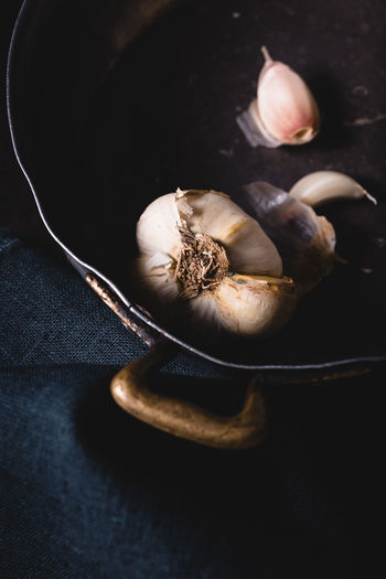 High angle view of garlic in bowl on table