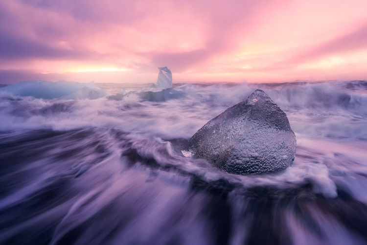The famous Jokulsarlon Beach in Iceland Beauty In Nature Cloud - Sky Cold Temperature Iceberg Iceland Nature No People Outdoors Scenics Sea Seascape Sky The Great Outdoors - 2017 EyeEm Awards Water Wave Weather