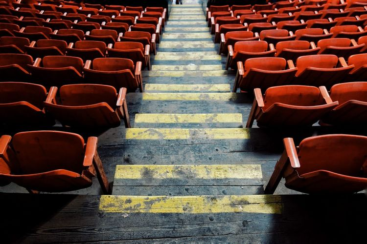 the stands. In A Row Repetition Seat Large Group Of Objects Red Order The Way Forward Arrangement Stands Color Sporting Event Crowd Yellow Lines Arena Fair Fairground