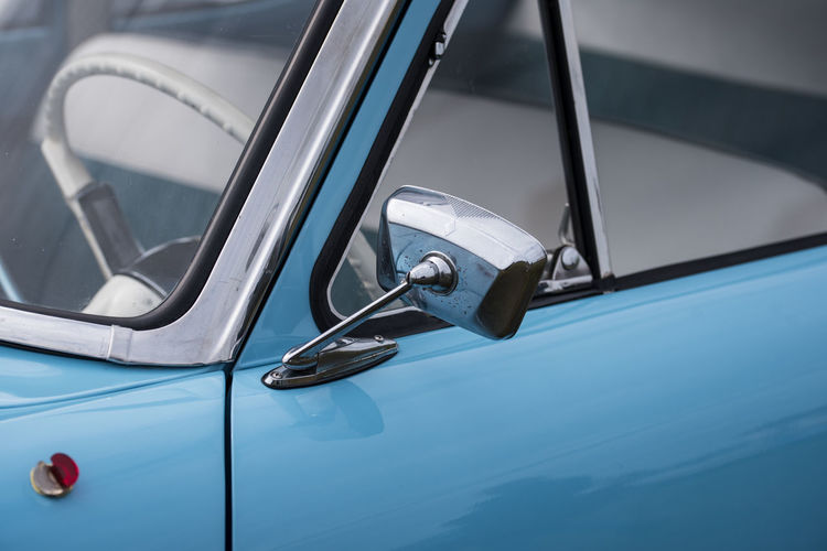 Blue Car Car Door Chrome Close-up Day Focus On Foreground Land Vehicle Luxury Metal Mode Of Transportation Motor Vehicle Nautical Vessel No People Outdoors Rear-view Mirror Retro Styled Silver Colored Stationary Steering Wheel Transportation Travel Vehicle Part Vintage Car Wheel