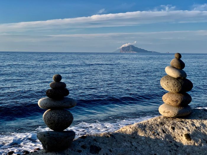 Water Sea Sky Rock Stack Stone - Object Solid Scenics - Nature Tranquil Scene Nature Beauty In Nature Zen-like Balance Rock - Object Stone Tranquility Pebble Horizon Cloud - Sky No People