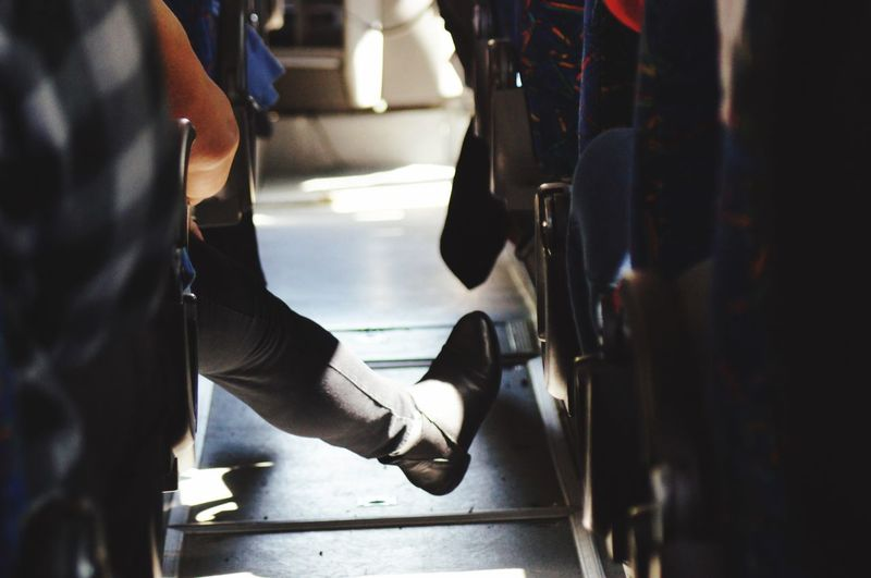 Low section of woman sitting in bus