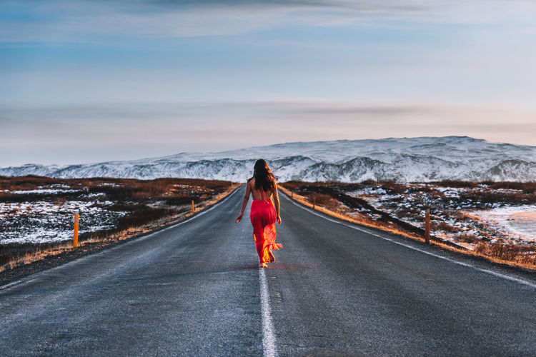 Barefoot Dress Freedom Iceland Red Dress Woman Background Beauty In Nature Clothing Cloud - Sky Cold Temperature Direction Female Girl Landscape Mountain Mountain Range Nature One Person Outdoors Real People Road Street Wallpaper Winter Women