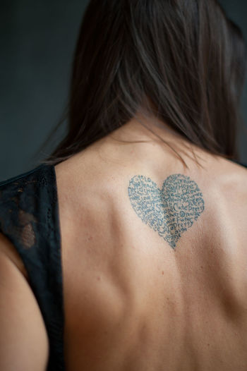 Rear view of woman with tattoo