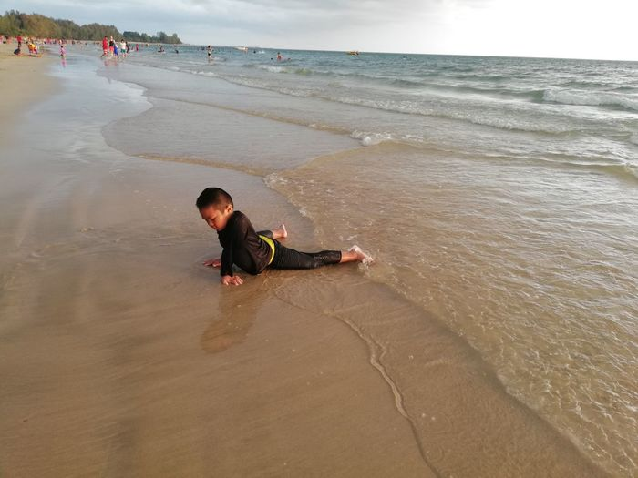 Children enjoy on summer trip 2019,หาดเจ้าหลาว Achi2019 Beach Water Sea Land Sand Real People Lifestyles One Person Boys Leisure Activity Men Childhood Beauty In Nature Child Nature Motion Full Length Wave Day Horizon Over Water Outdoors Innocence Boy