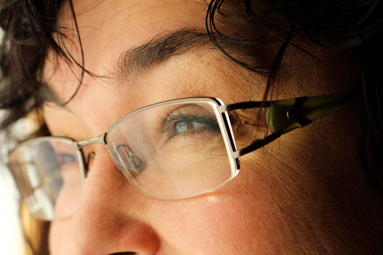Close-up of woman wearing eyeglasses