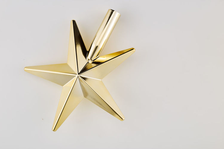 Studio Shot White Background Single Object Celebration Indoors  Christmas No People Copy Space Holiday Still Life Shiny Paper Close-up Decoration Star Shape Christmas Decoration Gold Colored Event Cut Out Silver Colored